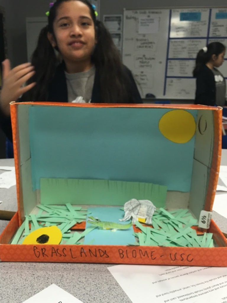student with grasslands biome