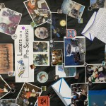 Letters to a Pre-Scientist bulletin board, with photos of scientists and stickers decorating a black background.