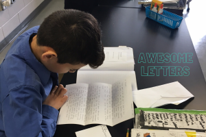 Student reads letter from pen pal
